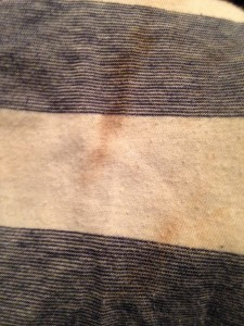 Even soaking this shirt in olive oil and scrubbing it three times with Fels Naphtha couldn't take the tar stain away.
