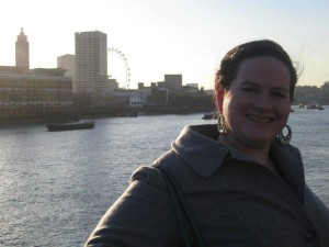 Mindy on the banks of the Thames with the London Eye behind her